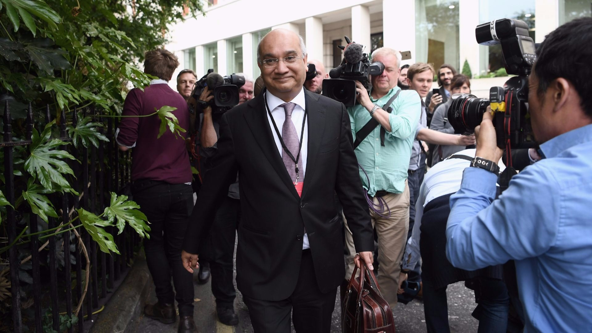 MP Keith Vaz walking down the street.