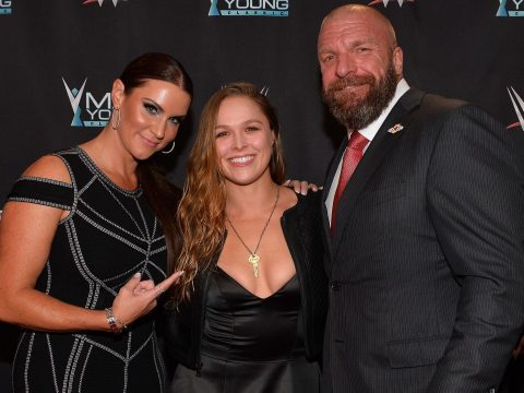 Stephanie McMahon, Ronda Rousey and Triple H.