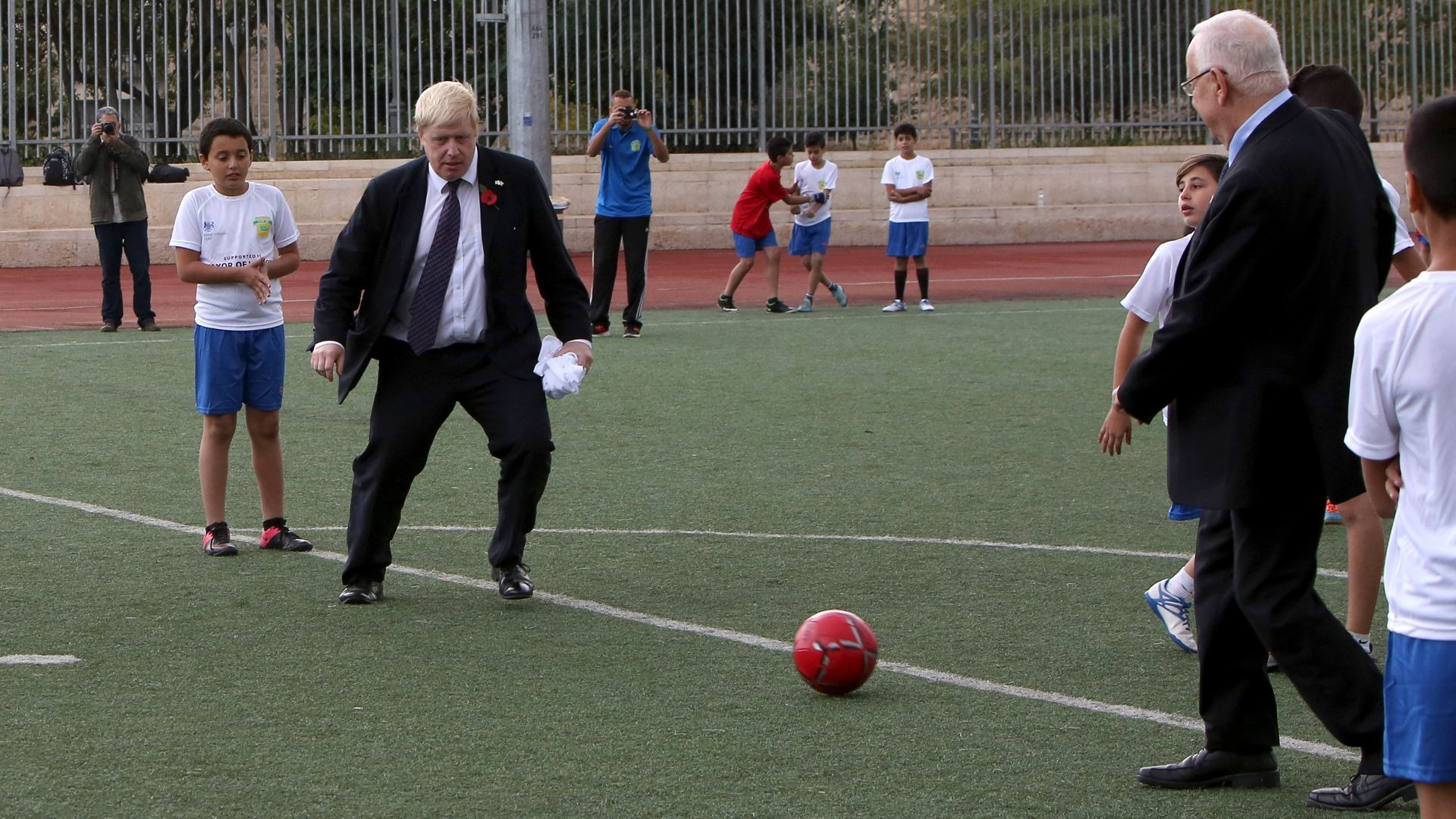 Boris Johnson attempting to play football.
