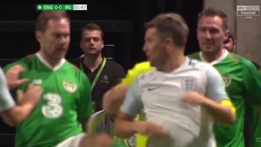 Enter title here Jason McAteer and Michael Owen clash during heated Ireland vs England all-star 'friendly'.